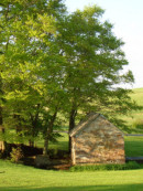 springhouse in spring - side of page